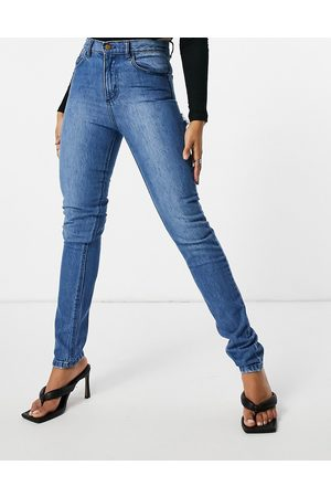Femme Luxe Straight leg jean with distressed bum detail in mid wash