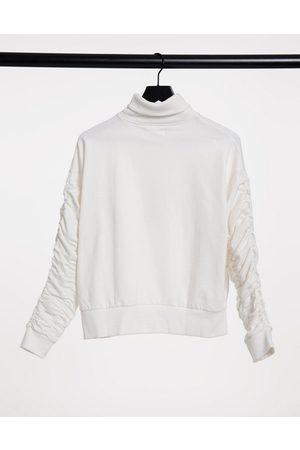 Urban Bliss Ruched sleeve sweater in cream