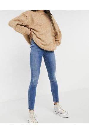 Vero Moda Sophia high rise skinny jean with distressing in medium