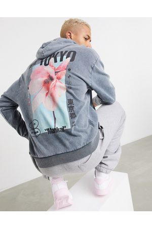 ASOS Oversized hoodie in heavy acid wash with Tokyo flower back print