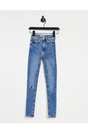 New Look Women Jeans - Fray hem ripped mid rise jean in