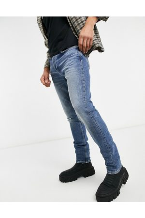 Bellfield Tapered ripped jeans in stone wash