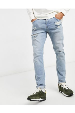 ASOS Stretch slim jeans in light wash with abrasions