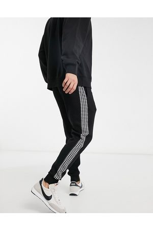 River Island Dogtooth check jogger in black