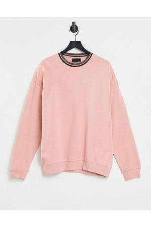 ASOS Oversized sweatshirt with tipping in pastel