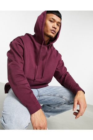 ASOS Organic oversized hoodie with curved hem in burgundy