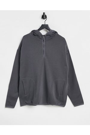 ASOS Hoodie with half zip and side split in washed black