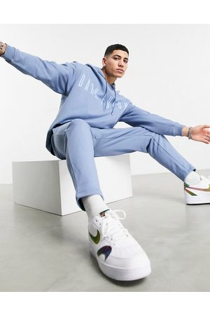 ASOS Dark Future Tracksuit in with chest logo