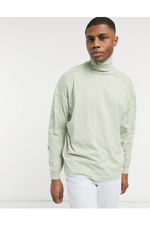 ASOS Oversized high neck top with seam detail in washed pastel