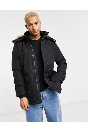 Tommy Hilfiger Technical quilted parka in with faux fur trim
