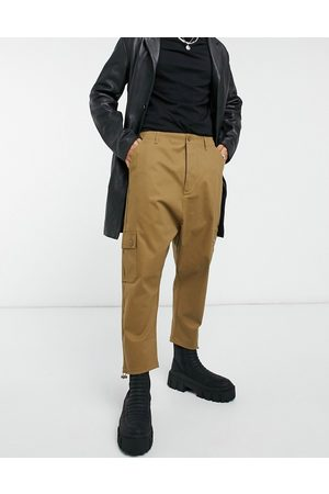 ASOS Drop crotch cargo trousers in brown with toggles