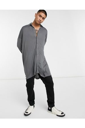 ASOS Extreme oversized long line viscose jersey shirt in washed