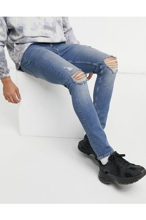 ASOS Skinny jeans in dirty mid wash with rips