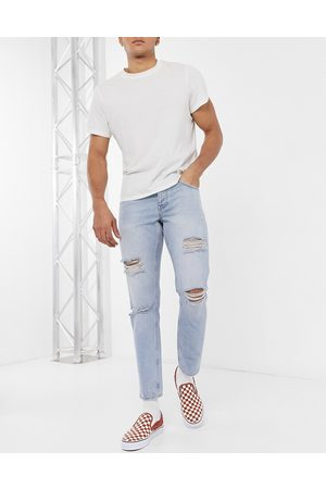 ASOS Slim jeans in vintage light wash with heavy rips