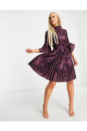 Chi Chi London Fluted sleeve mini dress in berry floral