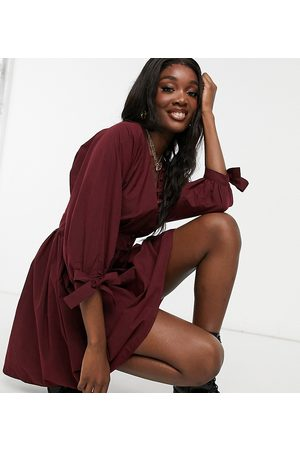 ASOS ASOS DESIGN Tall cotton poplin button detail mini smock dress with tie sleeves in oxblood