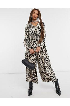 ASOS Button front relaxed jumpsuit in animal print
