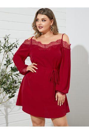 YOINS Plus Size Backless Design Belt Design Spaghetti Strap Lace Long Sleeves Mini Dress