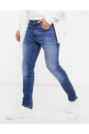 Tommy Hilfiger Austin slim tapered jeans in mid wash