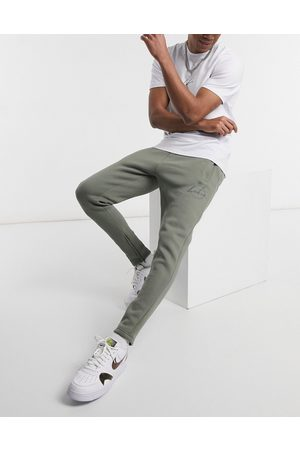 The Couture Club Slim fit archive update embroidered joggers in