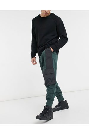 ASOS Oversized joggers in deep with washed black nylon utility details & deep rib
