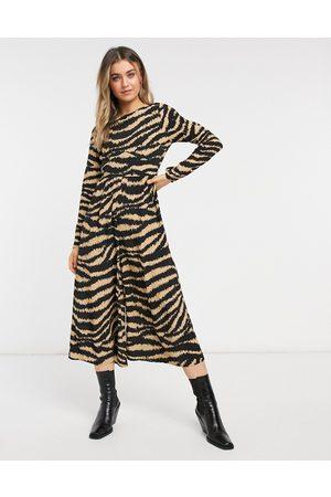 ASOS Long sleeve button back tea jumpsuit in animal print-Multi