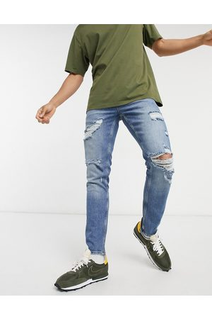 ASOS Stretch slim jeans in vintage mid wash with heavy rips
