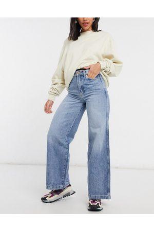 Wrangler High rise wide leg jeans in bleach wash