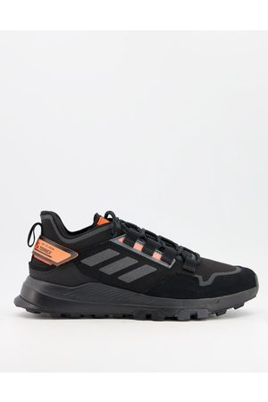 adidas Adidas Outdoors Terrex Hikester trainer in and orange