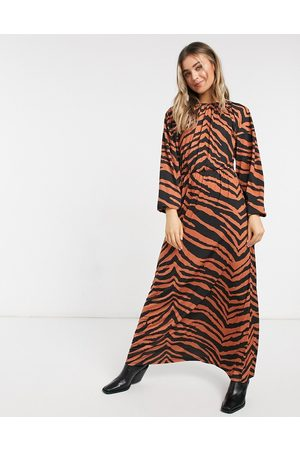 ASOS Maxi long sleeve dress in slinky rust zebra print