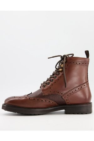 ASOS Brogue boots in leather with borg lining on sole