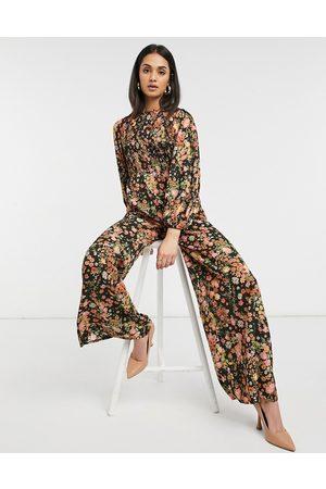 ASOS DESIGN Shirred jumpsuit in warm floral print