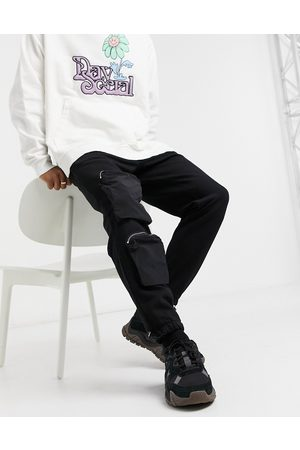 ASOS Tapered joggers with nylon utility pockets in