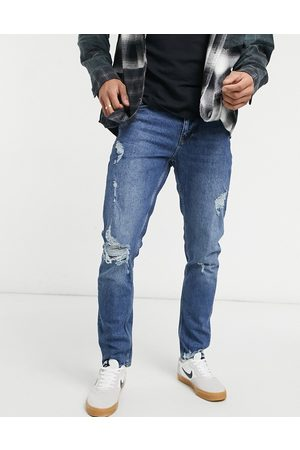 ASOS Slim jeans in dark wash with abrasions