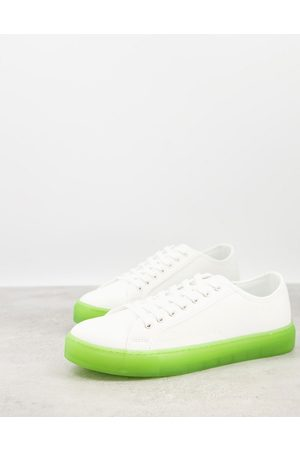ASOS Lace up plimsolls in with green transparent sole