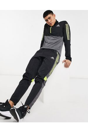 adidas Adidas Running track pants in and yellow
