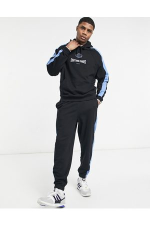ASOS Oversized tracksuit with side panels and chest print in & blue