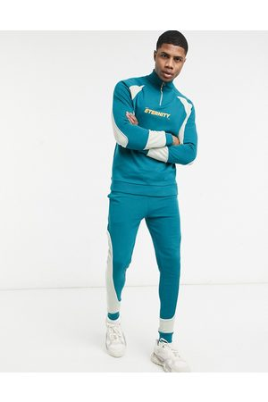 ASOS Tracksuit with half zip in colour block panels & chest print
