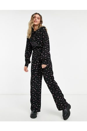 ASOS Oversized frill collar jumpsuit in ditsy rose print