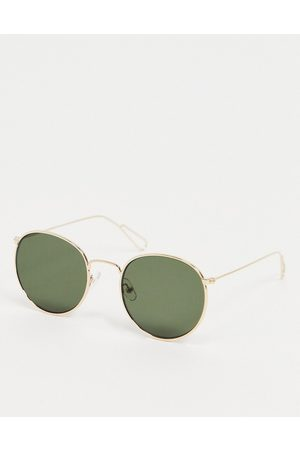 Weekday Explore Rounded Sunglasses in with Green Lenses