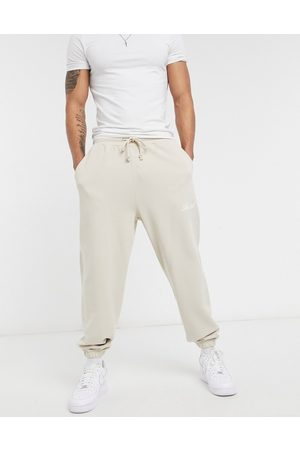 ASOS Actual Co-ord relaxed joggers in with script print