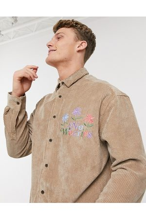 ASOS 90s oversized chunky cord shirt in tan with embroidery slogan