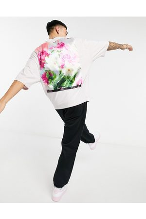 ASOS Oversized t-shirt in lilac with back flower print