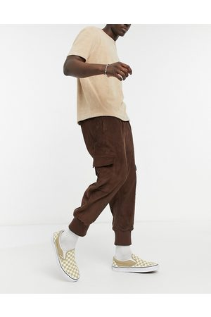 ASOS Oversized drop crotch trousers with cargo pockets & jersey cuffs in cord