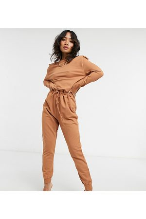 ASOS ASOS DESIGN petite long sleeve shoulder pad jogger jumpsuit in rust