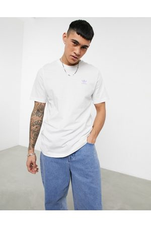 adidas Essentials t-shirt in with small lilac logo