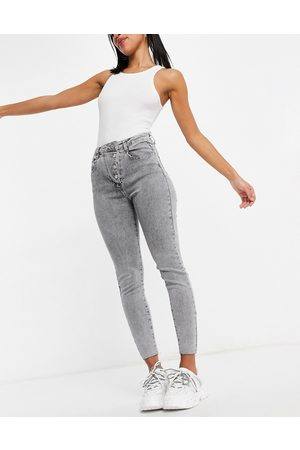 Missguided Aysmmetric button jeans in acid wash