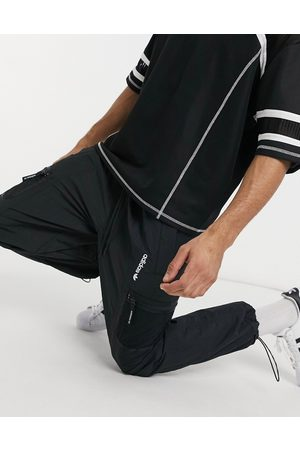 adidas Adventure woven joggers with pocket detail in