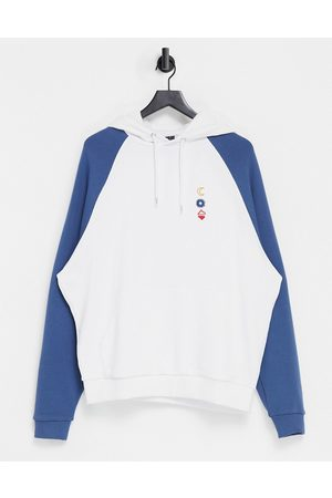 ASOS Oversized raglan hoodie in with washed blue sleeves & chest line drawing