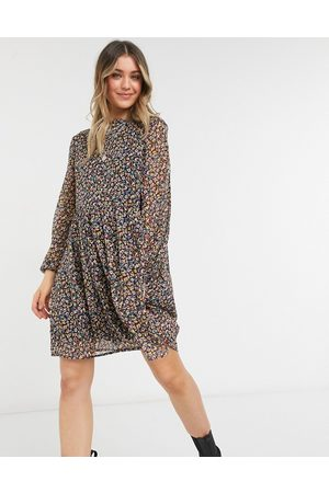 Pieces Mini smock dress with volume sheer sleeve in ditsy floral